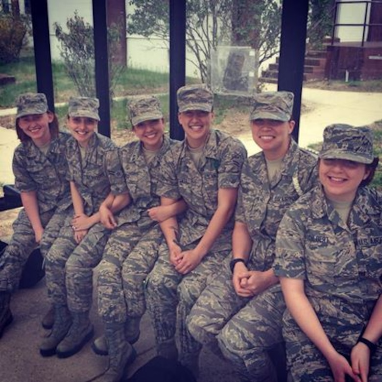 Airman 1st Class Jessica Smith (second from left) and a group of her fellow public affairs Airmen sit at a bus stop at Fort Meade, Md., 2014. The military provides an opportunity to meet new people from various backgrounds and build lifelong friendships. (Courtesy photo)