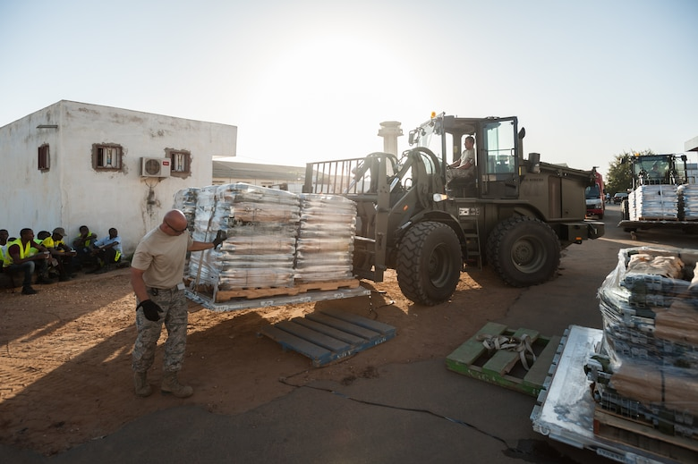 U.S. Air Force aerial porters from the Kentucky Air National Guard's 123rd Contingency Response Group prepare hundreds of cots for shipment aboard military cargo aircraft at Léopold Sédar Senghor International Airport in Dakar, Senegal, Oct. 29, 2014. The cots are headed to Monrovia to support U.S. forces engaged in Operation United Assistance, the U.S. Agency for International Development-led, whole-of-government effort to contain the Ebola virus outbreak. (U.S. Air National Guard photo by Maj. Dale Greer)
