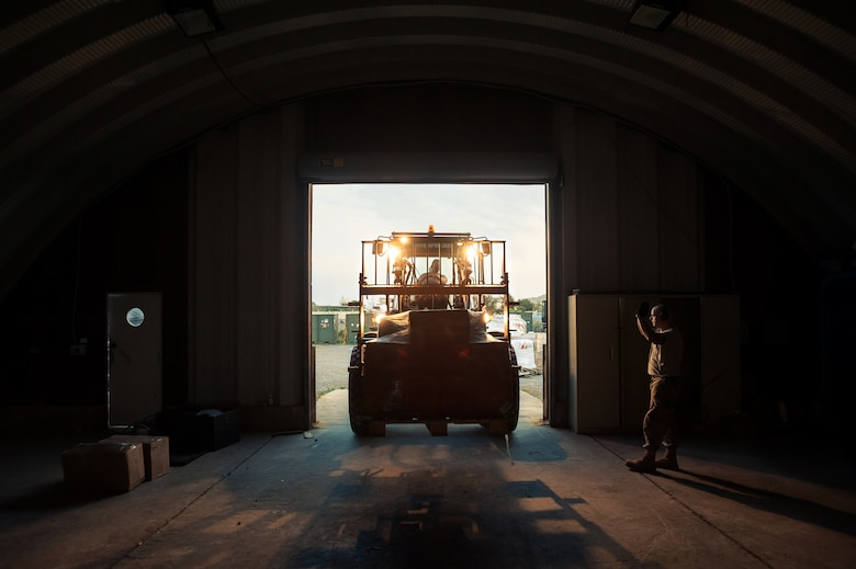 U.S. Air Force Tech. Sgt. Jarrod Blanford, an aerial porter from the Kentucky Air National Guard's 123rd Contingency Response Group, directs the placement of humanitarian cargo in a storage warehouse at Léopold Sédar Senghor International Airport in Dakar, Senegal, Oct. 28, 2014. More than 70 Kentucky Air Guardsmen are operating an Aerial Port of Debarkation in Senegal to funnel humanitarian supplies and military support into West Africa as part of Operation United Assistance, the U.S. Agency for International Development-led, whole-of-government effort to contain the Ebola virus outbreak. (U.S. Air National Guard photo by Maj. Dale Greer)