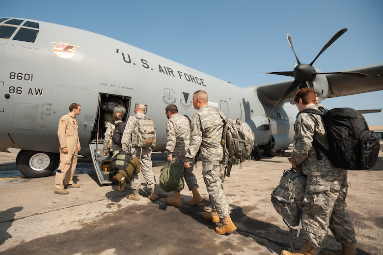 A group of service members, including Soldiers from the U.S. Army Corps of Engineers' Forward Engineering Support Team based in Wiesbaden, Germany, boards a U.S. Air Force C-130 Hercules at Léopold Sédar Senghor International Airport in Dakar, Senegal, Oct. 22, 2014. The engineers are bound for Liberia, where they will build medical treatment units as part of Operation United Assistance, the U.S. Agency for International Development-led, whole-of-government effort to respond to the Ebola outbreak in West Africa. The Soldiers' departure was coordinated by Airmen from the Kentucky Air National Guard's 123rd Contingency Response Group, which operates an Intermediate Staging Base at the Dakar airport. (U.S. Air National Guard photo by Maj. Dale Greer)