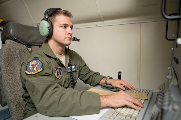 U.S. Air Force Capt. Brandon Rieker, an air battle manager with the 116th Air Control Wing, Georgia Air National Guard, sits at an operator work station aboard an E-8 Joint STARS aircraft, Robins Air Force Base, Ga., Oct. 18, 2014. Rieker was selected to attend the U.S. Air Force Weapons School, Weapons Instructor Course at Nellis Air Force Base, Las Vegas, Nev. Air battle managers are primarily responsible for command and control of battle management and with ensuring the day to day air mission is executed with success. (U.S. Air National Guard photo by Senior Airman Kari Giles/released)