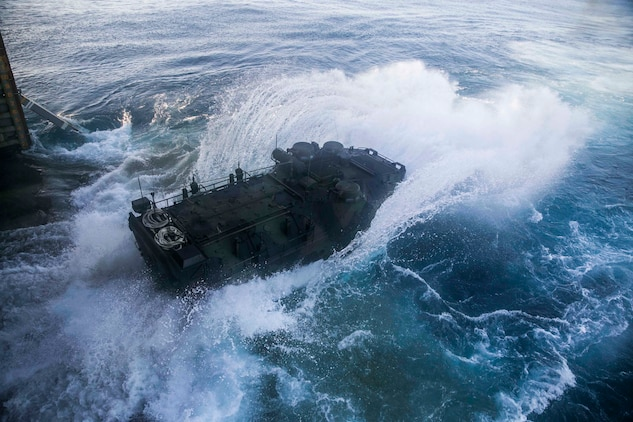 Marines launch their Assault Amphibious Vehicle from the hull of the USS Germantown (LSD 42) Nov. 2 during exercise Blue Chromite 15. Blue Chromite demonstrates the Navy and Marine Corps' amphibious and expeditionary capabilities from the sea. The Marines are with Combat Assault Battalion, 3rd Marine Division, III Marine Expeditionary Force.