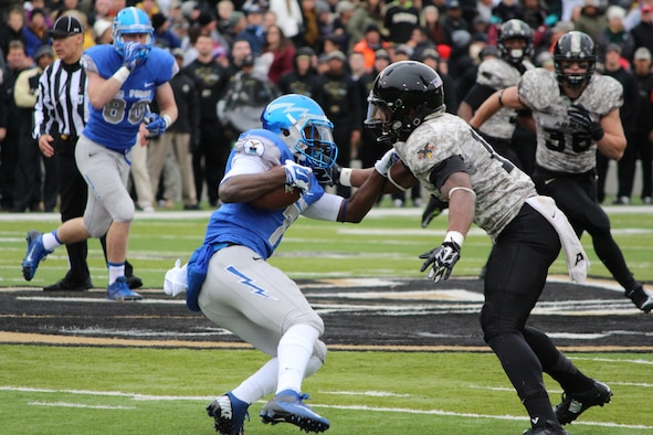 Air Force Falcon wide receiver Garrett Brown tries to elude Army's defense on the field Nov. 1, 2014, at the Falcons vs. Black Knights game at the U.S. Military Academy, N.Y. Air Force won, 23-6, securing the Commander-in-Chief's Trophy for the 19th time. Brown, an Academy junior, ran two catches for 54 yards and had four rushes for a total of nine yards. (U.S. Air Force photo/Cadet 3rd Class Alex Lee)