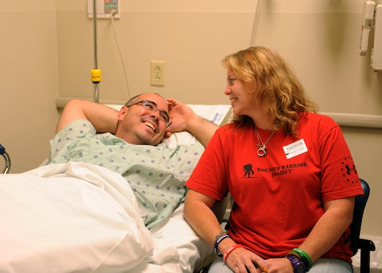 Tech. Sgt. Jason Caswell and his wife, Tami, share a moment before he enters surgery Oct. 17, 2014, at the Baptist Health Medical Center, Little Rock, Ark. Caswell injured his leg while playing rugby, and has suffered multiple complications, which led up to him choosing amputation of his leg. Caswell is a 19th Aircraft Maintenance Squadron crew chief. (U.S. Air Force photo/Airman 1st Class Scott Poe)