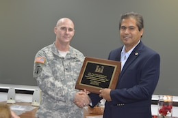 Pablo Vazquez-Ruiz receives the Construction Management Excellence award from district commander, Col. Alan Dodd. The award recognizes district personnel who exhibit excellence in construction management and contract administration activities.