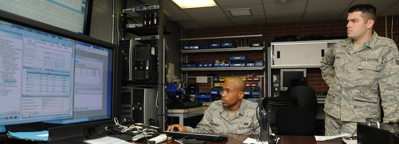 Airman 1st Class Jeshurun Marbury (left) and Senior Airman James Owens, 744 Communication Squadron radio frequency technicians, examine an access control point for a land-to-mobile radio trunking system at the 744 CS building here on Aug. 26, 2014. The 744 CS is responsible for LMR communications, the giant voice and public address system. (U.S. Air Force photo/Airman 1st Class Joshua R. M. Dewberry)