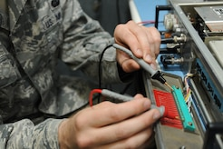 Senior Airman Zachary Saunders, 744 Communication Squadron radio frequency technician, examines a ground-to-air radio receiver at the 744 CS building at Joint Base Andrews, Md., on Aug. 26, 2014. The 744 CS is responsible for land-to-mobile communications, the giant voice and public address system. (U.S. Air Force photo/Airman 1st Class Joshua R. M. Dewberry)