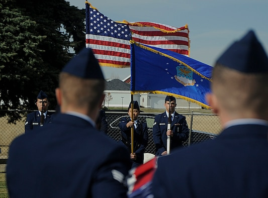 New honor guard graduates carry an empty casket towards the flag bearers Oct. 31 during a mock funeral at the F.E. Warren Air Force Base, Wyo., cemetery. Each graduate had a different responsibility to perform during the ceremony. (U.S. Air Force photo by Airman 1st Class Brandon Valle)