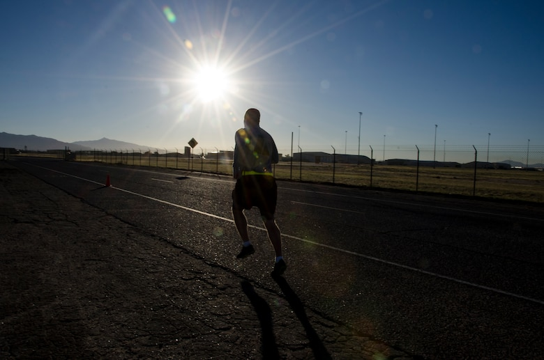 A member of the 1st Battlefield Coordination Detachment finishes the run portion of the Army physical fitness test at Davis-Monthan AFB, Ariz.,  Nov. 4, 2014. Performance on the test  is strongly linked to a soldier's fitness level and his or her ability to do fitness related tasks. (U.S. Air Force photo by Staff Sgt. Adam Grant/Released)