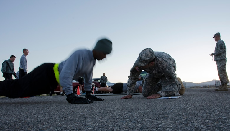 A member of the 1st Battlefield Coordination Detachment performs push-ups during the Army physical fitness test at Davis-Monthan AFB, Ariz., Nov. 4, 2014. Once all members have completed the push-up portion of the fitness test they will then move on to the sit-up portion. (U.S. Air Force photo by Staff Sgt. Adam Grant/Released)