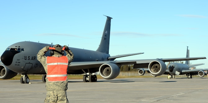 Staff Sgt. Joshua Hood marshals a KC-135 Stratotanker for takeoff during exercise Vigilant Shield 15 at 5 Wing Goose Bay, Newfoundland and Labrador, Oct. 23, 2014. The Vigilant Shield field training exercise is a bi-national NORAD Command exercise which provides realistic training and practice for American and Canadian forces in support of respective national strategy for North America's defense. NORAD ensures U.S. and Canadian air sovereignty through a network of alert fighters, tankers, airborne early warning aircraft, and ground-based air defense assets cued by interagency and defense surveillance radars. (U.S. Air Force photo by Airman 1st Class Colby L. Hardin/Released)