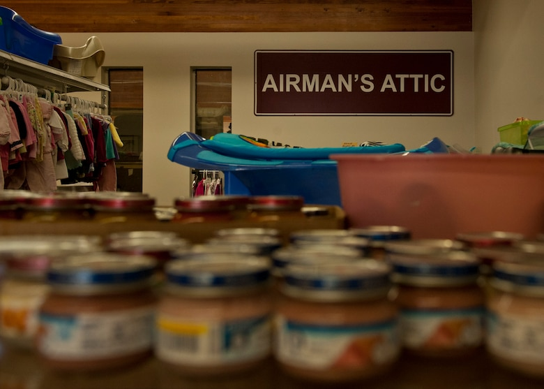 PETERSON AIR FORCE BASE, Colo. – The sign from the old location hangs on the wall as a reminder of where they started and how far they've come at the Airman's Attic. The Airman's Attic is a place where Airmen in grades E-5 and below can get household goods, clothes, children's toys and miscellaneous items for free. Military uniforms are also available for free to all ranks. (U.S. Air Force photo/Airman 1st Class Rose Gudex)
