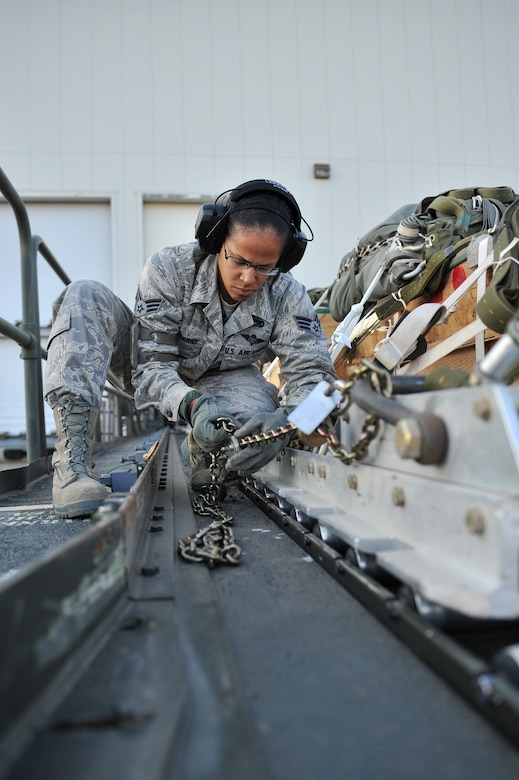 ALTUS AIR FORCE BASE, Okla. – U.S. Air Force Senior Airman Rangeline Rosario, 97th Logistics Readiness Squadron air transportation journeyman, secures a cargo pallet onto a Tunner 60K aircraft cargo loader Oct. 30, 2014. Once the pallet is secured onto the cargo loader, it can be transported to the U.S. Air Force C-17 Globemaster III cargo aircraft for used in an airdrop training mission by the 58th Airlift Squadron. (U.S. Air Force Photo by Senior Airman Dillon Davis/Released)