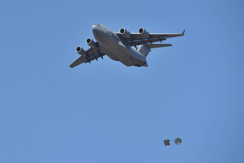 HOLLIS, Okla. – A U.S. Air Force C-17 Globemaster III cargo aircraft drops a cargo pallet during an airdrop training mission Oct. 30, 3014. The 58th Airlift Squadron, from Altus Air Force Base, performs airdrop training missions to ensure that the loadmasters-in-training are fully qualified to perform real-world contingency and humanitarian missions worldwide. (U.S. Air Force Photo by Senior Airman Dillon Davis/Released)