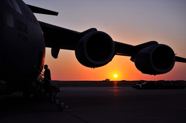 ALTUS AIR FORCE BASE, Okla. – A crew member from the 97th Air Mobility Wing boards a U.S. Air Force C-17 Globemaster III cargo aircraft before a training flight Oct. 30, 2014. The 58th Airlift Squadron's mission is to train tomorrow's C-17 pilots and loadmasters to support the U.S. Air Force and contingency operations worldwide. (U.S. Air Force Photo by Senior Airman Dillon Davis/Released)