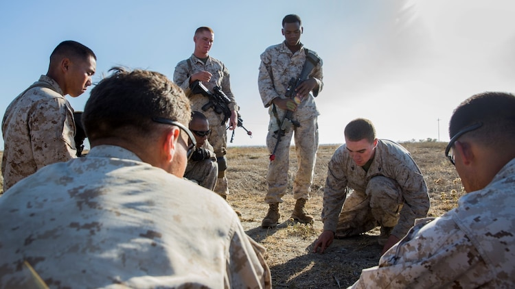 U.S. Marine Cpl. Jose W. Delgado conducts rock drills with his squad during a vertical-assault raid course aboard Camp Pendleton, Calif., Oct. 27, 2014. Delgado is from Shirley, N.Y., and is a squad leader with Lima Company, Battalion Landing Team 3rd Battalion, 1st Marine Regiment, 15th Marine Expeditionary Unit. (U.S. Marine Corps photo by Sgt. Emmanuel Ramos/Released)