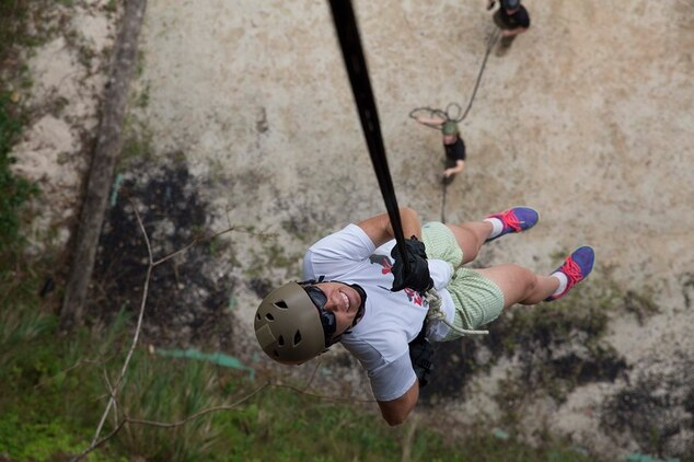 Julia C. Weidner descends during a rappel event Oct. 25 during Junglefest 2014 at the Jungle Warfare Training Center on Okinawa, Japan. The festival allowed Okinawa community members and U.S. service members to see and experience some of the military training techniques that the instructors at the JWTC teach during the jungle survival training course. Weidner, from Miami, Florida, is the spouse of an active duty service member stationed on Okinawa.