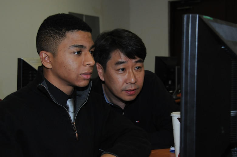 Sin Choe, district mechanical engineer, explains to Seoul American High School senior Warren Nieto how the process of design analysis works.