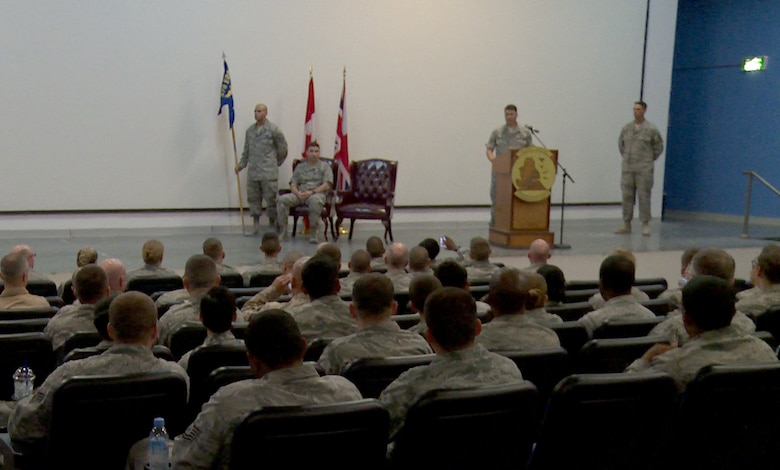 U.S. Air Force Lt. Col. Stuart Williamson, 71st Expeditionary Air Control Squadron commander, speaks during an inactivation ceremony for the 71st EACS Nov. 1, 2014, at Al Udeid Air Base, Qatar. The 71st EACS's mission was transferred to the 727th EACS.