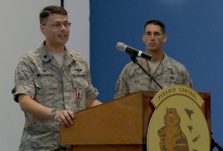 U.S. Air Force Lt. Col. Stuart Williamson, 71st Expeditionary Air Control Squadron commander, speaks during an inactivation ceremony for the 71st EACS Nov. 1, 2014, at Al Udeid Air Base, Qatar. Since being activated in 2006, the 71st EACS provided command and control via remote radar, radio and datalink hubs in the area of responsibility and has maintained positive control of every aircraft in their airspace.