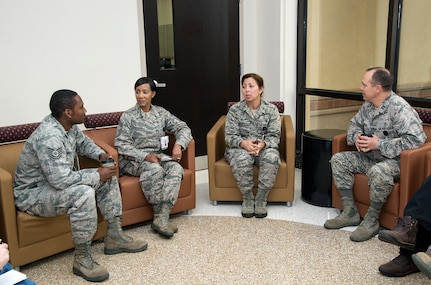 "Col. Dana James, 359th Medical Group commander (third from left), and Chief Master Sgt. Sonya Stoute, 359th MDG superintendent (second from left), discuss patient care with Tech. Sgt. Jean-Baptiste Museau (at left) and Capt. David Wooten (at right) Nov. 4, 2014 at Joint Base San Antonio-Randolph The 359th MDG held a ""Free Coffee with Commanders"" event to offer patients and staff a free cup of coffee and an opportunity to discuss patient care experiences with medical group leaders. Museau is bioenvironmental engineering flight chief with the 359th Aerospace Medicine.  Wooten is officer in charge of Occupational Health & Readiness with the 359th Aerospace Medicine. (U.S. Air Force photo by Johnny Saldivar)"