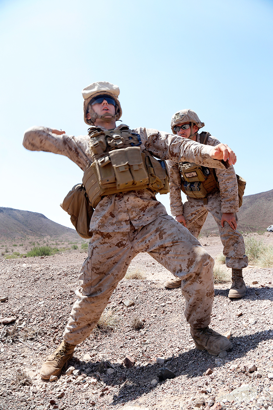 U S  Marine Corps Sgt  Robert J  Scarpello, right, observes