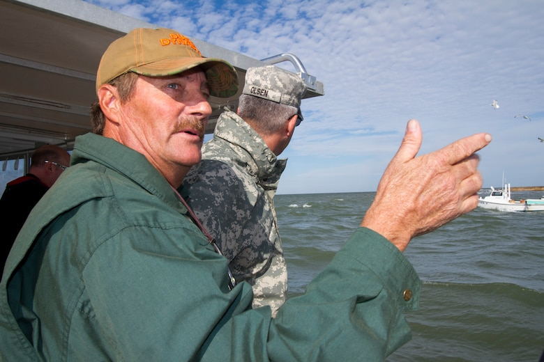 "TANGIER, Va. – James ""Ooker"" Eskridge, mayor of Tangier, points out some areas of concern to Col. Paul Olsen, Norfolk District commander, during a boat tour of Tangier Island. The district is working on a jetty project for the island as well as dredging the island's navigation channel."