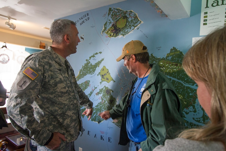 "TANGIER, Va. – James ""Ooker"" Eskridge, mayor of Tangier, points out some areas of concern to Col. Paul Olsen, Norfolk District commander, on a map at the Tangier Island history museum here November 3, 2014. The district is working on a jetty project for the island as well as dredging the island's navigation channel."