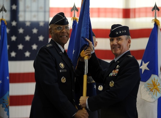 Vice Chief of Staff Gen. Larry O. Spencer, left, passes the Air Combat Command guidon to Gen. Hawk Carlisle during ACC's change of command ceremony Nov. 4, 2014, at Langley Air Force Base, Va. Carlisle assumed command from Gen. Mike Hostage, who retired after 37 years of service to the Air Force. (U.S. Air Force photo/Staff Sgt. Candice Page)