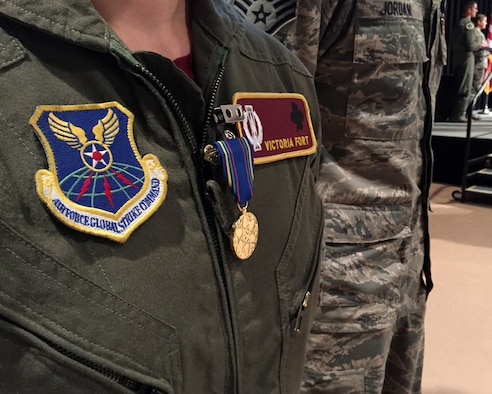 First Lt. Victoria Fort dons the very first Nuclear Deterrence Operations Service Medal  Nov. 5, 2014, during Air Force Global Strike Command's 2014 Global Strike Challenge at the Bossier Civic Center, Bossier City, La.  Fort is a missile combat crew instructor from the 91st Missile Wing at Minot Air Force Base, N.D. (U.S. Air Force photo/1st Lt. Christopher Mesnard)