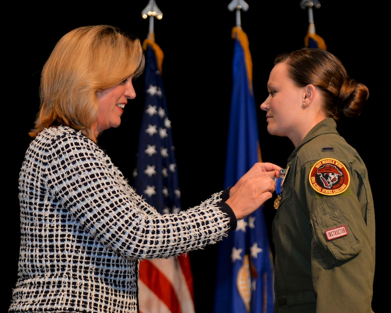 Secretary of the Air Force Deborah Lee James presents the very first Nuclear Deterrence Operations Service Medal to 1st Lt. Victoria Fort Nov. 5, 2014, during Air Force Global Strike Command's 2014 Global Strike Challenge in Bossier City, La. This milestone recognizes the importance and unique demands of the nuclear deterrence mission and the dedication of the Airmen who perform it.  Fort is a missile combat crew instructor from the 91st Missile Wing at Minot Air Force Base, N.D. (U.S. Air Force photo/Senior Airman Benjamin Gonsier)