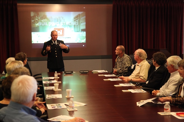 U.S. Army Engineering and Support Center  commander Col. Robert Ruch briefs a group of retired U.S. Army Corps of Engineers' Senior Executive Service members and their spouses the Oct. 29 for the first Leaders Emeritus , visit to the Center. The group meets every 18 months and visits U.S. Army Corps of Engineers' organizations to keep current with USACE operation and how the Corps continues to provide service to the nation.