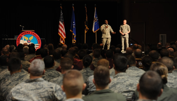 Chief Master Sgt. of the Air Force James A. Cody (right) and Command Sgt. Maj. Patrick Alston speak to a crowd of nearly 800 Airmen and attendees Nov. 5, 2014, at the Global Strike Challenge 2014 Technology and Innovation Symposium in the Bossier Civic Center, Bossier City, La. Cody and Alston talked about core values and profound leadership. Alston is the senior enlisted leader at U.S. Strategic Command. (U.S. Air Force photo/Senior Airman Janelle Dickey)