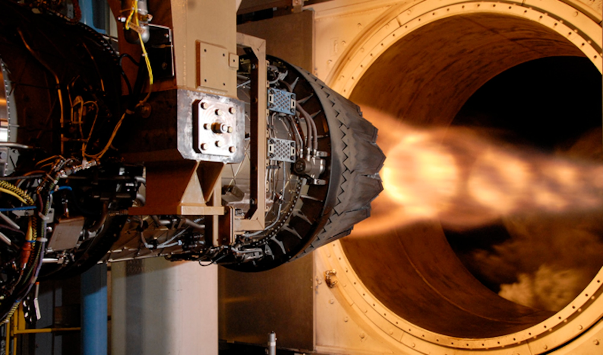 A Pratt & Whitney F135 engine for the Conventional Take-Off and Landing version of the F-35 Lighting II Joint Strike Fighter completed a record-breaking accelerated mission test in the Sea Level 3 (SL-3) test cell at the Arnold Engineering Development Center at Arnold Air Force Base, Tenn. Shown here is a previous test of the F135 in the AEDC SL- 3 test cell. (Courtesy photo/Rick Goodfriend)