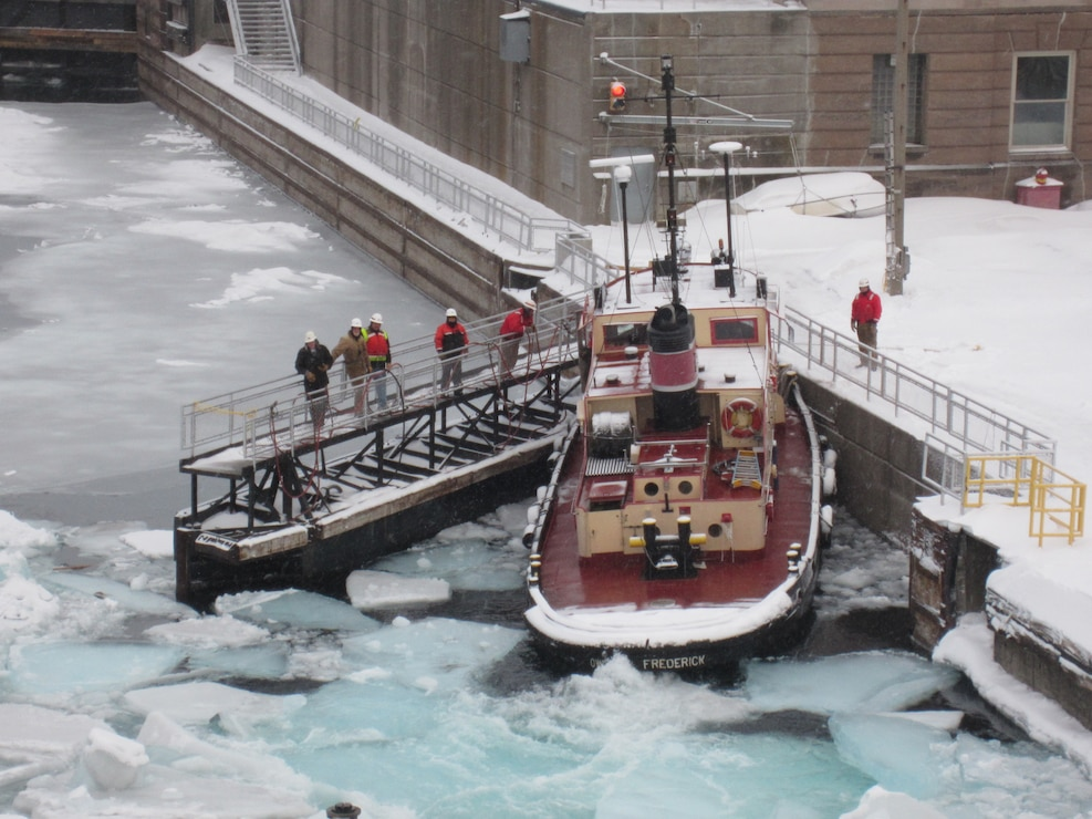The lockcrew observing the tugboat Fredrick, which is surrounded by ice during the winter of 2014, in which 92 percent of the Great Lakes froze over.