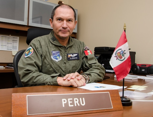 Col. Jaime Aleman smiles before preparing to execute his daily duties as a liaison officer Nov. 5, 2014, at Davis-Monthan Air Force Base, Ariz. Aleman, who has served eight months of his two year tour of duty as the Peruvian LNO, is using his time at Davis-Monthan AFB to build partner capacity between the United States and Peru, while improving his English language skills. Aleman is the Air Forces Southern Peruvian LNO. (U.S. Air Force photo/Staff Sgt. Adam Grant)