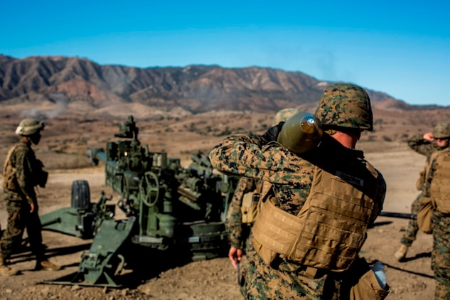 Marines with Battery B, 1st Battalion, 11th Marine Regiment, prepared to load an M77 Howitzer during a direct fire exercise aboard Marine Corps Base Camp Pendleton, Calif., Nov. 3, 2014. The training re-established specific close-quarters firing skills with the Marines, ensuring successful future combat operations