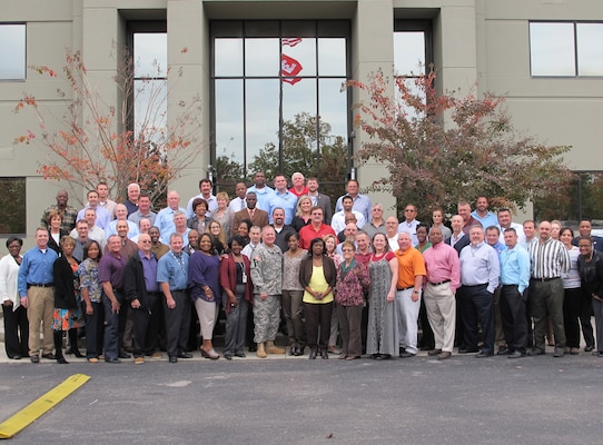 Huntsville Center Commander Col. Robert Ruch  (first row, center) takes a photo with veterans at the organization Nov. 5.