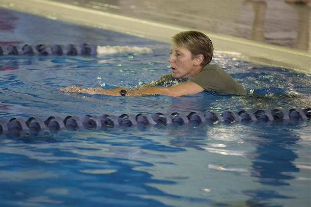 Gunnery Sgt. Kelly Anderson, assistant operations chief with the Provost Marshal's Office, participates in the Marine Corps Birthday swim at the indoor pool in the Iron Works gym aboard Marine Corps Air Station Iwakuni, Japan, Nov. 3, 2014. The squadron finished the, roughly, 149 mile swim in one day.