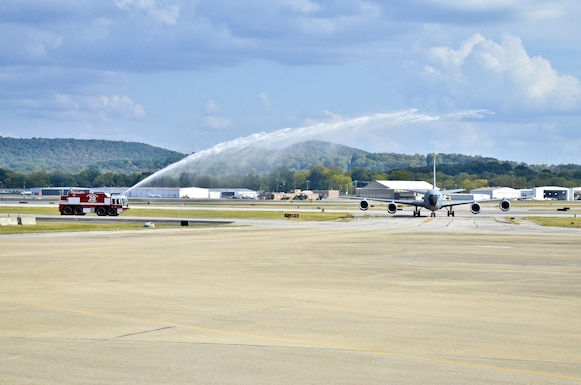 A KC-135R Stratotanker from the 117th Air Refueling Wing gets hosed down by a fire truck from the units fire department as a common celebration for a pilots final flight also know as a Fini Flight. (U.S. Air National Guard photo by: Senior Master Sgt. Ken Johnson/Released)