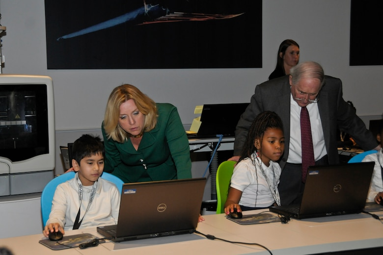 141106-Z-VF226-032 -- Secretary of the Air Force Deborah Lee James and U.S. Sen. Carl Levin, D-Mich., look at the work of school children participating in the STARBASE program at Selfridge Air National Guard Base, Mich., during a visit Nov. 6, 2014. STARBASE is a national program sponsored by the Dept. of Defense that provides science and technology educational programming to 5th graders. The STARBASE program began at Selfridge more than 20 years ago and now is in various locations in all 50 states. (U.S. Air National Guard photo by Brittani Baisden)