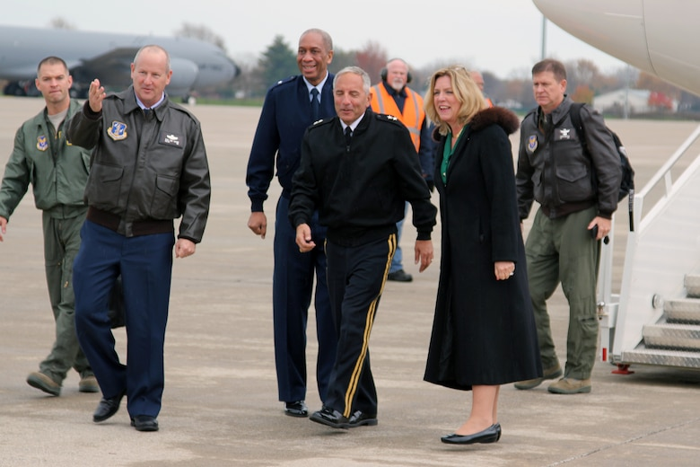 127th Wing commander Brig. Gen. John D. Slocum gestures the way as he, Brig. Gen. Leonard W. Isabelle Jr., Michigan Air National Guard commander; Major Gen. Gregory J. Vadnais, Michigan adjutant general; and Secretary of the Air Force Deborah Lee James head to the Base Operations building after James' arrival at Selfridge Air National Guard Base, Mich., Nov. 6, 2014. The visit by the secretary to Selfridge marked her 50th base visit since she became secretary in December 2013. (U.S. Air National Guard photo by Tech. Sgt. Dan Heaton)
