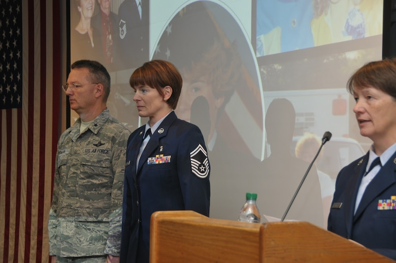 Master Sgt. Sally Baker (right), 109th Medical Group, reads the promotion order for newly promoted Chief Master Sgt. Jacqueline Sweet-McNeill during a ceremony with Brig. Gen. Anthony German, New York Air National Guard chief of staff, on Nov. 2, 2014. Sweet-McNeill is the 109th Medical Group superintendent. (U.S. Air National Guard photo by Tech. Sgt. Catharine Schmidt/Released)