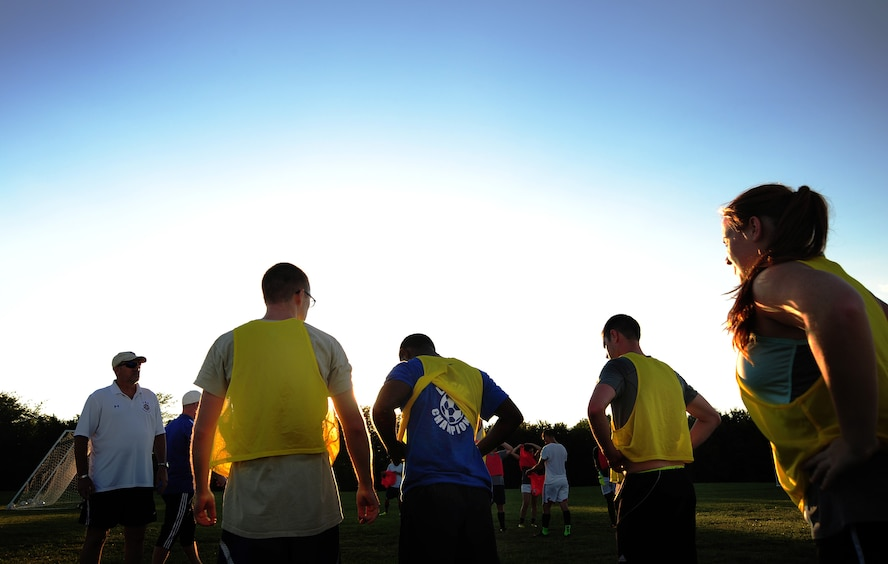 Members of the Sporting Whiteman soccer team take a 10-minute break during a practice session at Cloverdale Complex in Sedalia, Mo., Aug. 12, 2014. The team was preparing for the Defender's Cup, an Armed Forces soccer tournament, which they scored sixth place in against 36 other teams. (U.S. Air Force photo by Staff Sgt. Nick Wilson/Released)