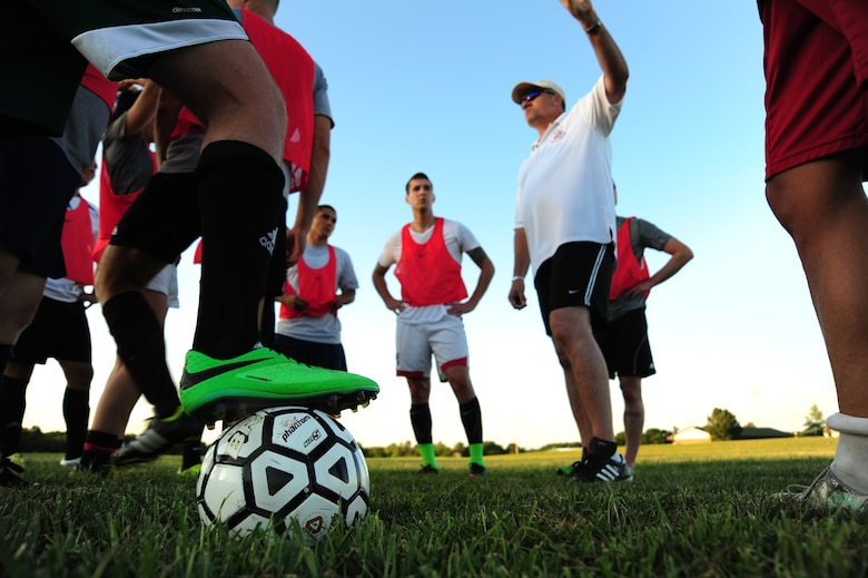 Roy Dietzman, Sporting Whiteman varsity soccer team head coach, mentors players on the importance of playing aggressively after a scrimmage at Cloverdale Complex in Sedalia, Mo., Aug. 12, 2014. The team practices twice a week and scrimmages against various semi-pro and collegiate soccer teams each month. (U.S. Air Force photo by Staff Sgt. Nick Wilson/Released)
