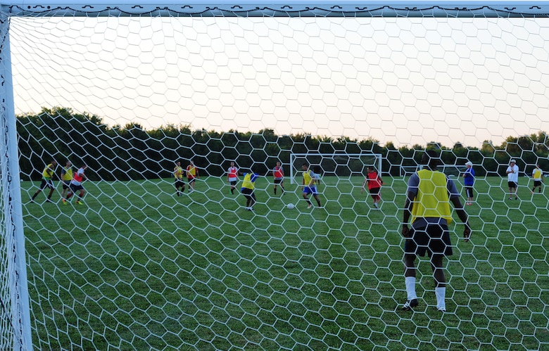 Members of the Sporting Whiteman soccer team play in a scrimmage during a practice session at Cloverdale Complex in Sedalia, Mo., Aug. 12, 2014. The team consists of enlisted members, officers, dependents and civilians assigned to Whiteman Air Force Base. (U.S. Air Force photo by Staff Sgt. Nick Wilson/Released)