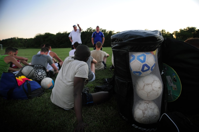 Roy Dietzman, Sporting Whiteman soccer team head coach, briefs players on ways to improve their playing style after a scrimmage scheduled for Labor Day at Cloverdale Complex in Sedalia, Mo., Aug. 12, 2014. The team plays competitively against various semi-pro and collegiate teams in the region. (U.S. Air Force photo by Staff Sgt. Nick Wilson/Released)