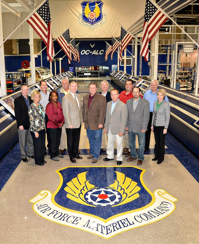 Air Force Materiel Command and American Federation of Government Employees Council 214 met at Tinker Air Force Base for a Partnership Council meeting Oct. 30-31. The purpose of the Partnership Council is to foster a culture of cooperation by involving the union early in the process as a way to jointly work issues and reach solutions. Council members in attendance are, from left, Dr. Todd Fore (AFMC/A1), Patsy Reeves (AFLCMC/CA), Randy Shaw (AFMC/A1KL), Pamela McGinnis (AFGEL-1138), Rocky Tasse (AFGEL-1942), Michael Gill (AFMC/CA), Troy Tingey (AFGE Council 214), David Robertson (AFTC/CA), Jeff Allen (AFSC/CA), Ty Norton (AFGE C214), Monty Lewis (AFGE L-1592), Tom Robinson (AFGE C214) and Gina Martinelli (AFMC/A1KL). (Air Force photo by Kelly White)