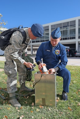 Academy Cadets 1st Class Max Johnson and Kyle Morse repack an airdrop practice model here created by a 2014 capstone project team working to mathematically model wind shear and speed to decrease the cost and increase the accuracy of combat zone airdrops. (U.S. Air Force photo)