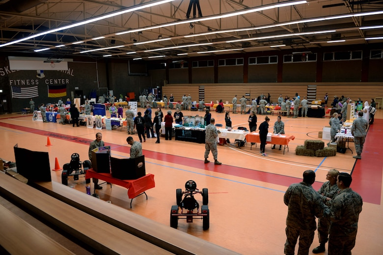 Spangdahlem Airmen and families interact with the 52nd Medical Group Airmen during the 2014 Fall Harvest Health Fair at the Skelton Memorial Fitness Center at Spangdahlem Air Base, Germany, Nov. 5, 2014. The medical group hosted the fair to promote health and fitness by providing free information, health checks and other services. (U.S. Air Force photo by Airman 1st Class Timothy Kim/Released)